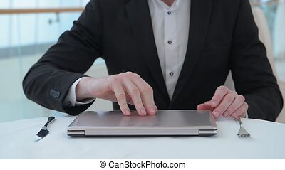 Businessman sitting at table in restaurant