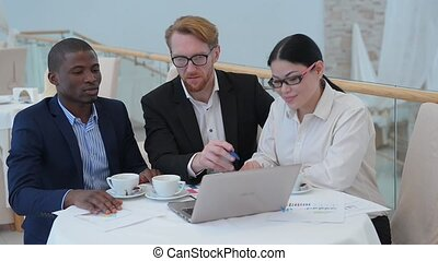 Business meeting in restaurant - Picture of businessman in...
