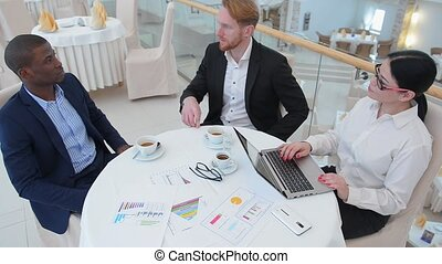 Business meeting in restaurant - Two businessmen...