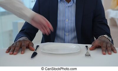 Businessman sitting at table in restaurant - Businessman...