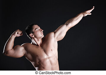 Strong athlete - Young man athlete with perfect body at...