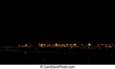 Boeing 777 landing at night - Boeing 777 approaching and...