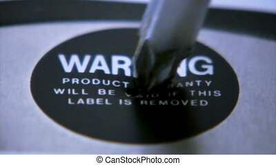 Destroying warranty label 1