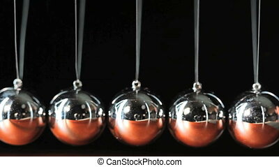 Close up of Newton\'s Cradle - Desk toy pendulum being...