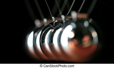 Close up of Newtons Cradle - Desk toy pendulum being...
