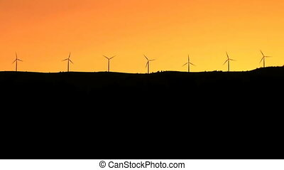 Wind turbines silhouette - Sunset and wind powered...