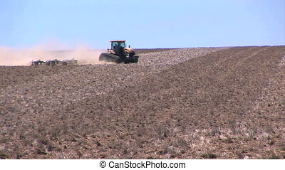 Tractor working the field - Tractor plowing a field,...