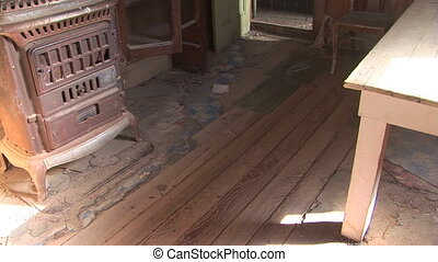 Inside a ghost town home - Interior of an abandoned home in...