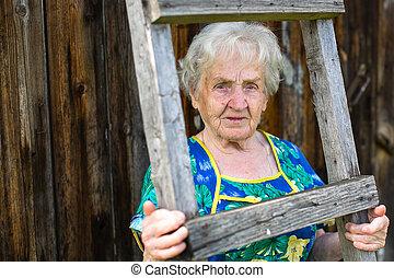 elderly woman portrait outdoors