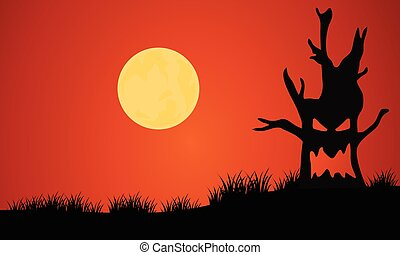 Silhouette of tree monster and full moon
