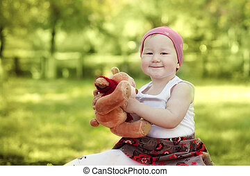 happy girl playing with Teddy Bear - happy little girl in...
