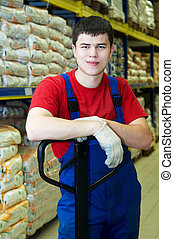 warehouse worker - young handsome warehouse worker man in...