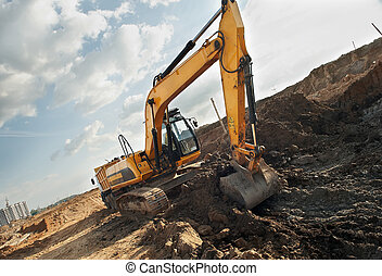 Excavator loader in construction sandpit area - Excavator...