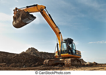 Excavator loader in construction sandpit area - Loader...