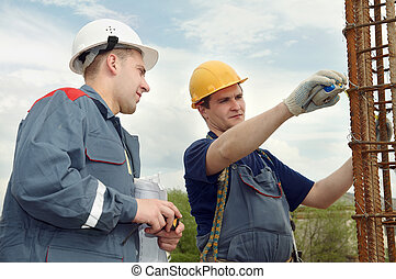 engineer accept construction works - two builders workers...