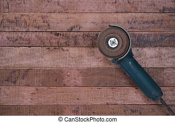 grinding machine tool on the wood board background