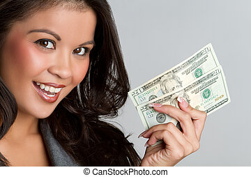 Woman Holding Money - Beautiful smiling asian woman holding...