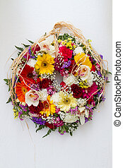 Easter Flower Wreath hanging on a white wall