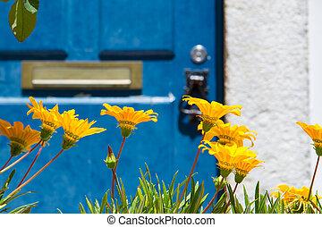 Blue door with yellow flowers - Front door with flowers