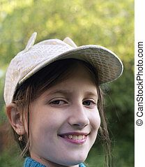 Happy Looking Girl - A girl wearing headwear with a happy...
