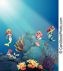 Mermaids swimming under the ocean illustration