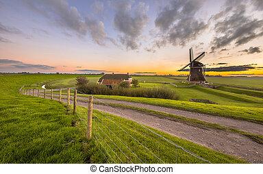 Dutch Wooden windmill in flat grassy landscape - Ultra wide...