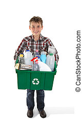 Boy holding recycling bin full or rubbish - A child holds a...