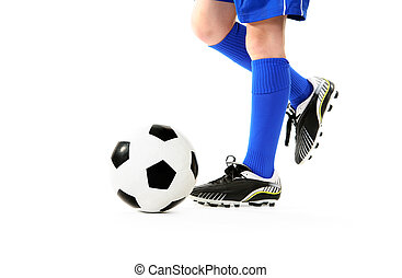 Boy kicking soccer ball - Boy kicking a soccer ball White...
