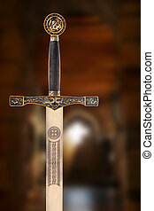 Medieval sword against a blurred background of an ancient...