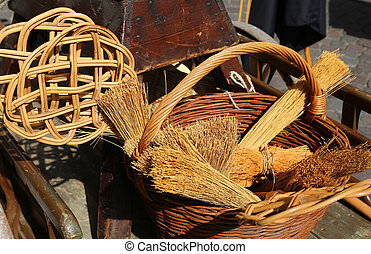 broom of sorghum, carpet beater and wicker containers -...