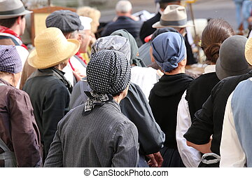 many people with old haircloth waiting - old people with old...