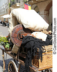 old cart with a mattress and other items of poor immigrant...