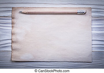 Vintage clean paper sheet pencil on wooden board directly...