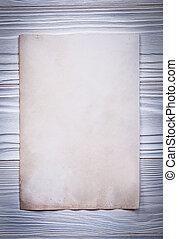 Vintage paper sheet for menu on wooden board