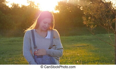 Beautiful pregnant woman on grass - Outdoor natural portrait...