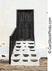 Old black door in Betancuria village on Fuerteventura,...