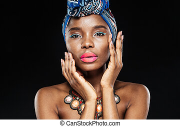 Close up portrait of an african woman posing with hands -...