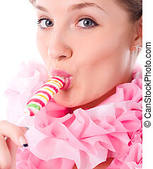 woman with candy - young woman in pink jabot with colored...