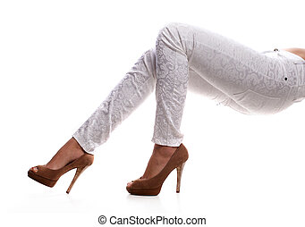 female legs - beautiful female legs in white trousers and...