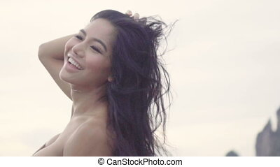Happy woman with wind in her hair - Asian beautiful happy...