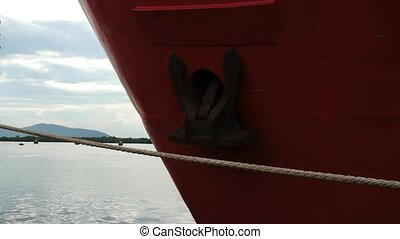 Bow of red metal ship rusty anchor