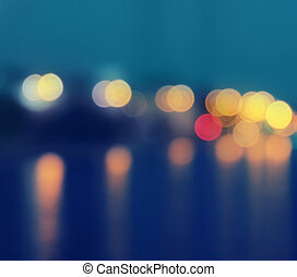 Square image of a blurred city lights with bokeh effect...