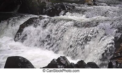 Slow motion video of rapids and rocks clip