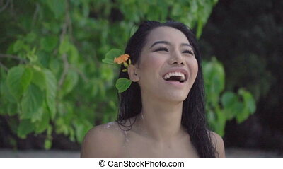 Happy woman on the beach. - Asian beautiful happy woman in...
