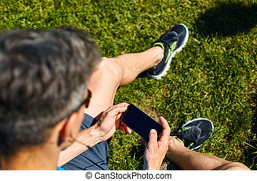 athlete with bottle of water and mobile phone - athlete...