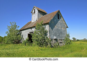 Old granary left in a field - An abandoned small granary or...