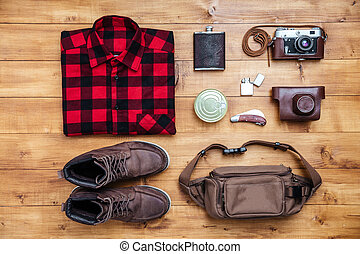 Travel concept boots, shirt, camera, lighter, flask, bag,...