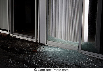 Home invasion - Shattered sliding glass door after an...