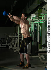 Kettle Bell Exercise - Young Man Working Out With Kettle...
