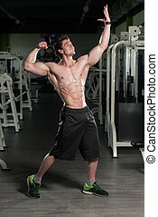 Healthy Man With Six Pack - Bodybuilder Posing In Different...